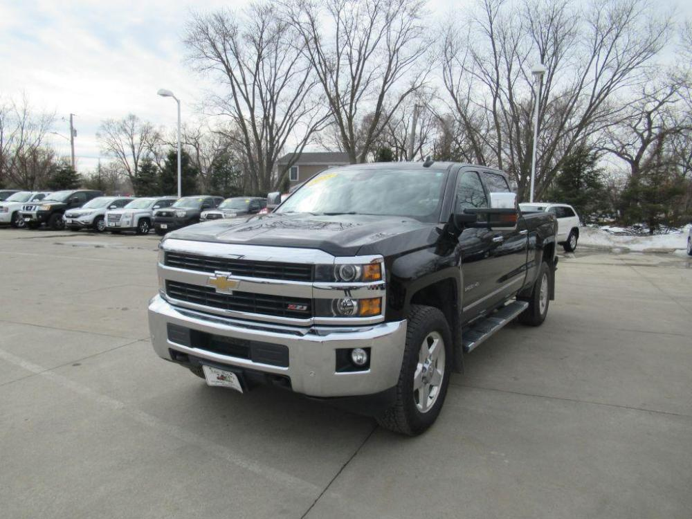 2015 BLACK CHEVROLET SILVERADO 2500 HEAVY DUTY LTZ (1GC1KWEG3FF) with an 6.0L engine, Automatic transmission, located at 908 SE 14th Street, Des Moines, IA, 50317, (515) 281-0330, 41.580303, -93.597046 - Photo #0