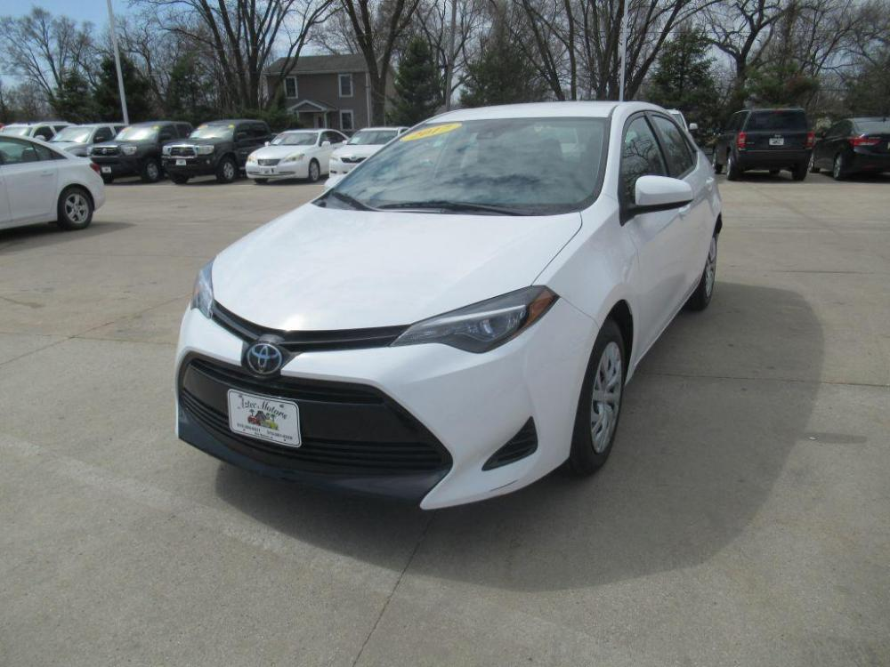 2017 WHITE TOYOTA COROLLA LE (5YFBURHE6HP) with an 1.8L engine, Continuously Variable transmission, located at 908 SE 14th Street, Des Moines, IA, 50317, (515) 281-0330, 41.580303, -93.597046 - Photo #0
